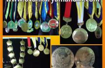 Gordon Wisuda | Medali | Lencana